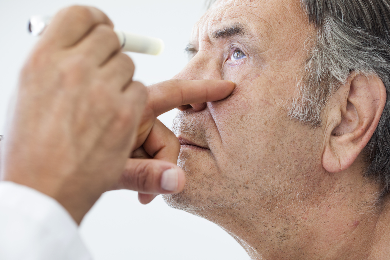 Older man being tested for thyroid eye disease treatment