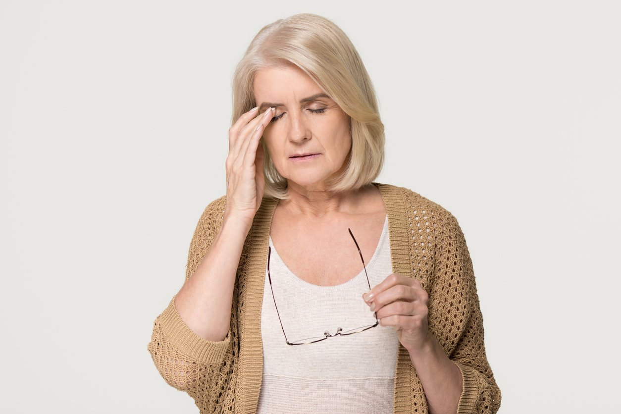 Woman with eyelid vein pain
