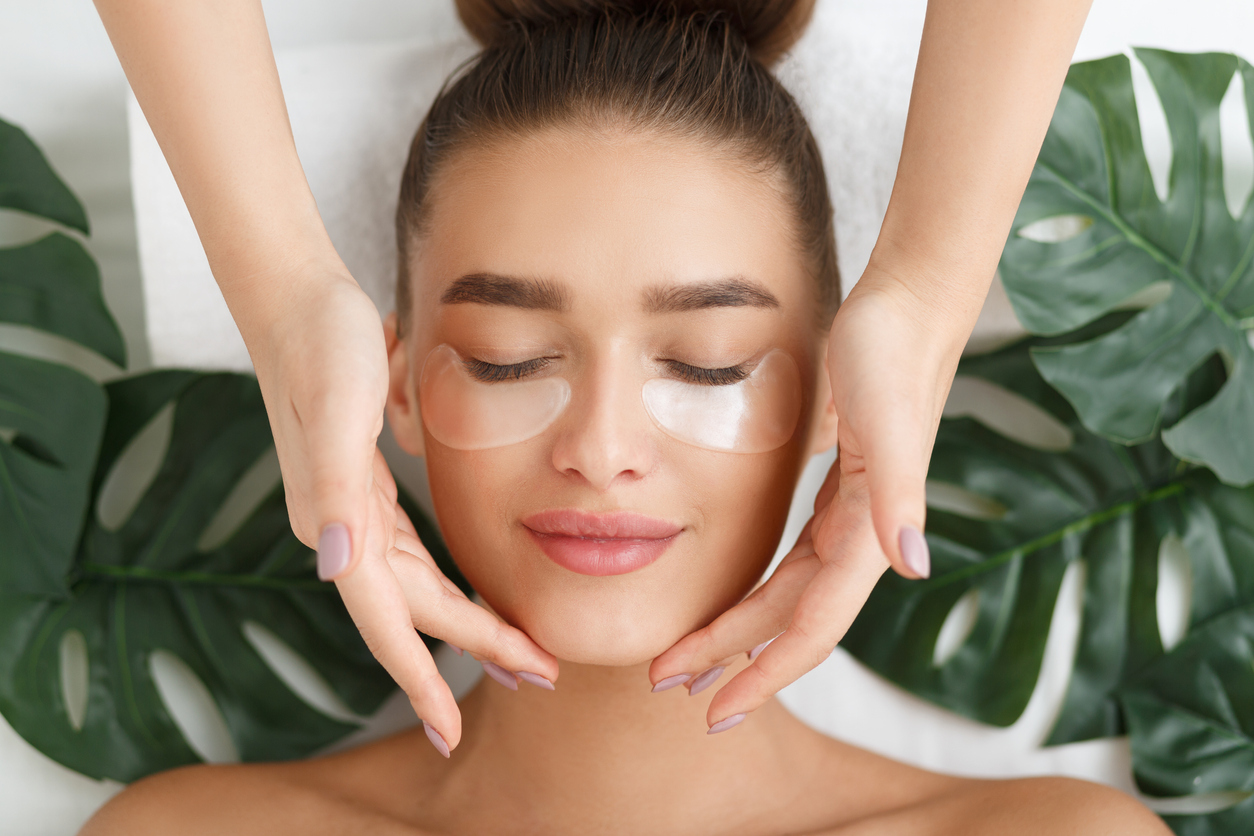 Woman with beauty treatment for skin around eyes