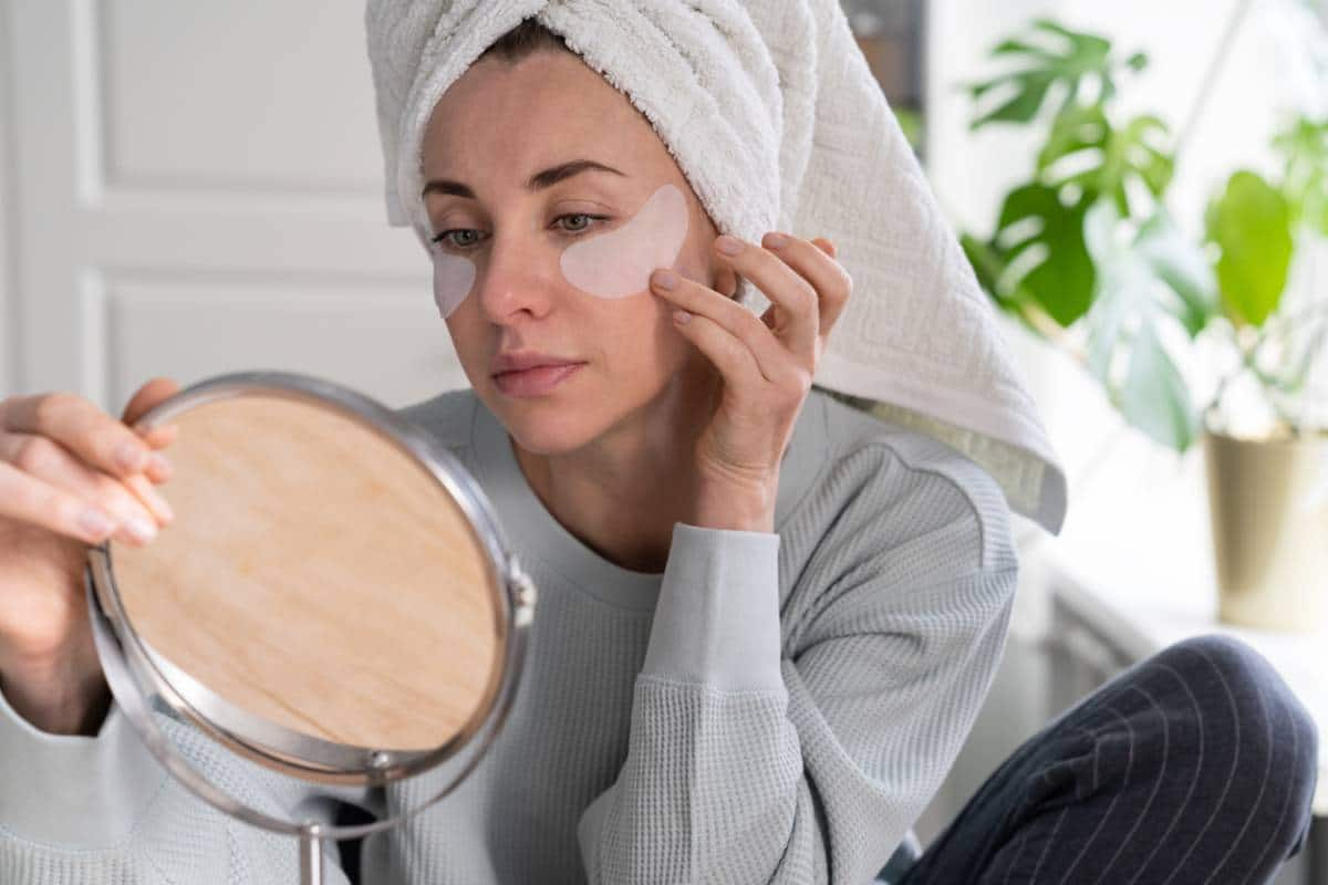 Woman checking her dark circles.